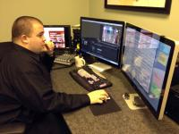Intern Ted Gulyas from George Mason University at the edit console.